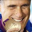 Romney biting the POTUS gold medal